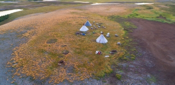 View from height on a settlement of nomads reindeer breeders in the valley of the Longotjyogan River (aerial photograph). Yamal, Russia